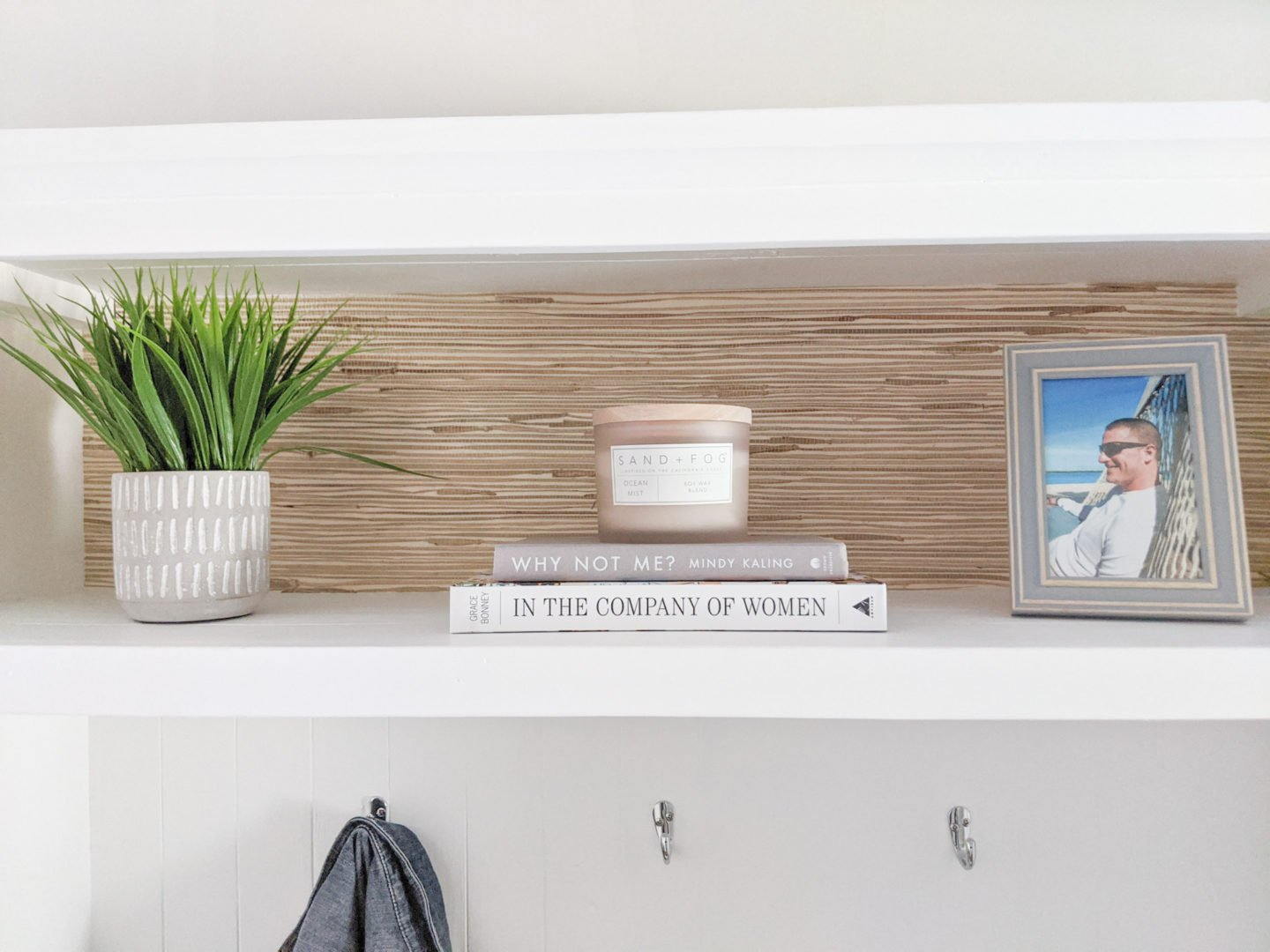 I kept the styling on the shelf simple to keep the grasscloth more visible