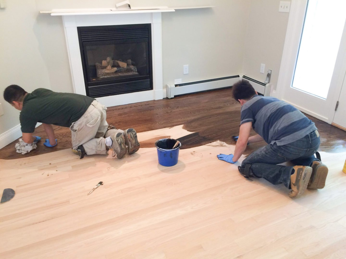 Applying the stain in our master bedroom