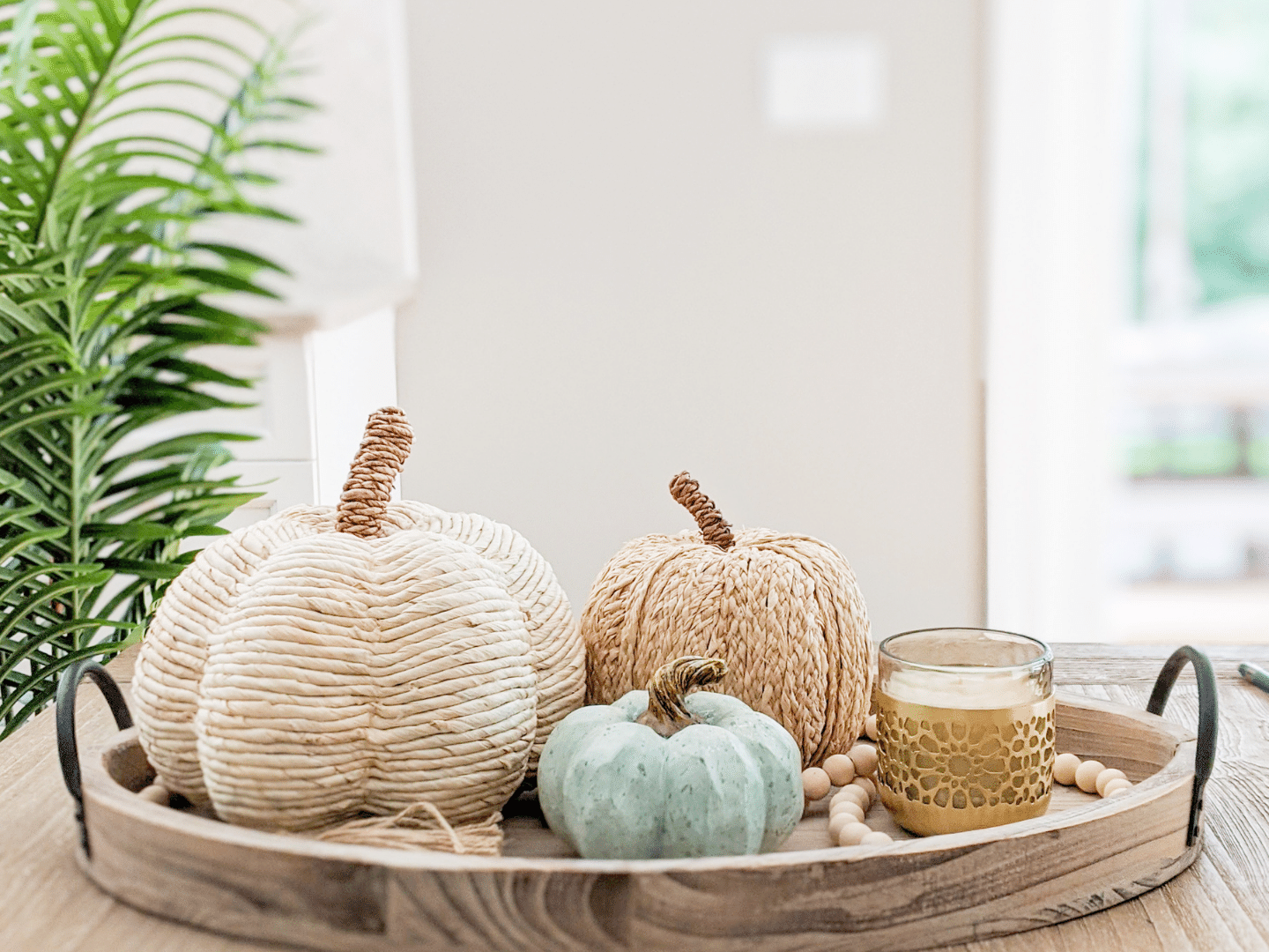 I styled the Corn Husk and Raffia Pumpkins on a tray with the Wood Bead Garland linked in the Tray & Tray Decor section below.