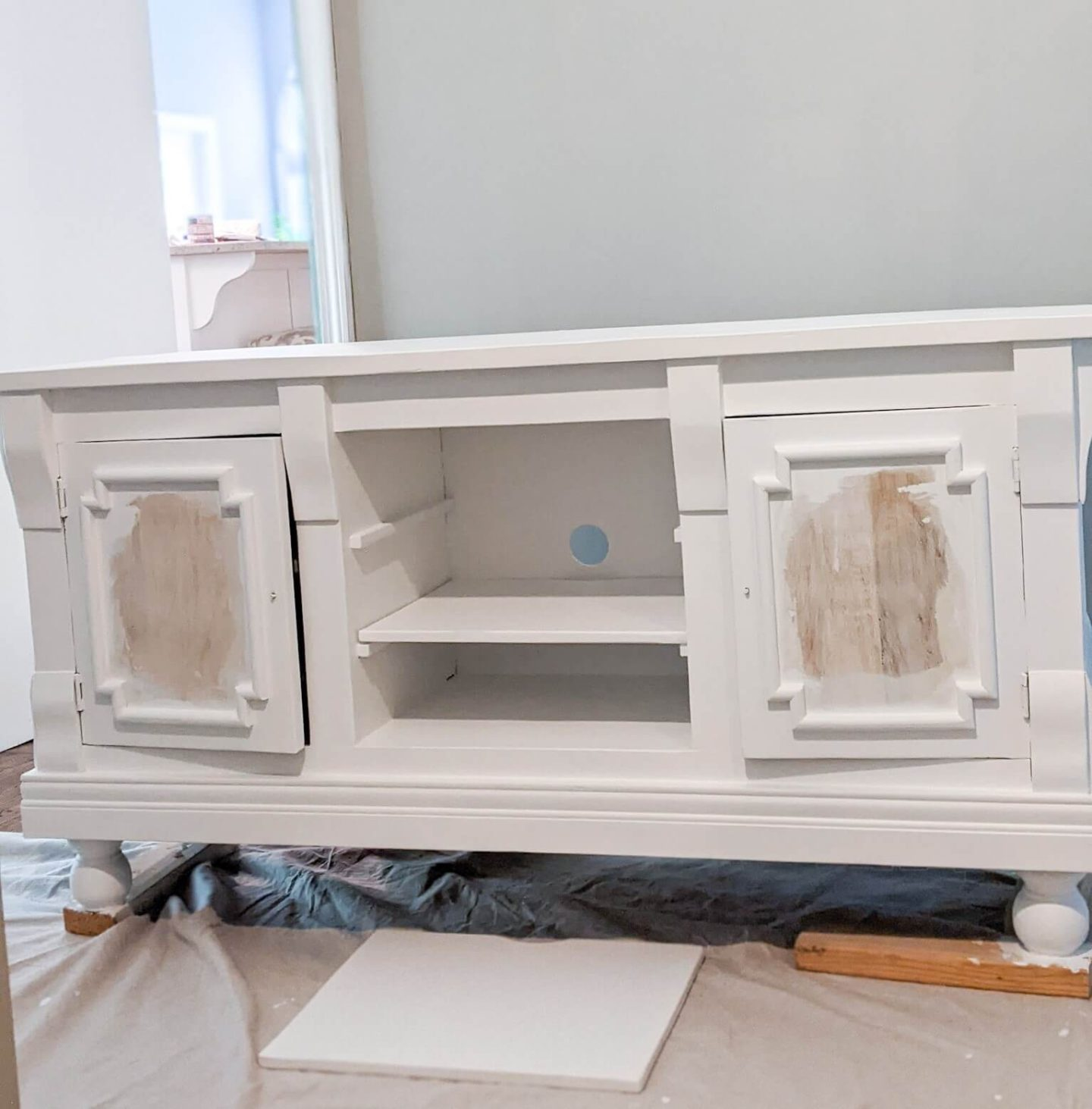 The TV console fully painted, ready for the grasscloth application