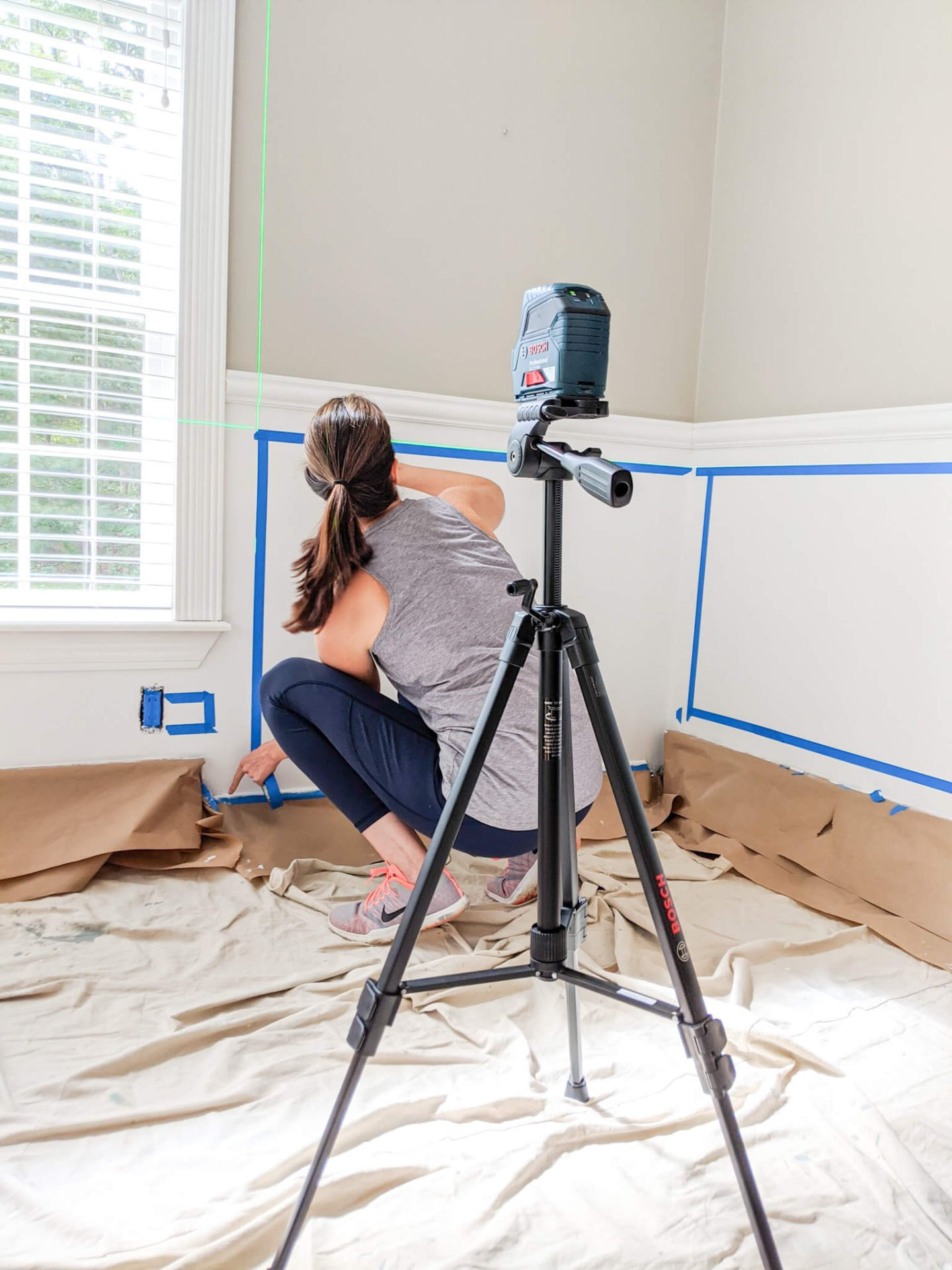 Retaping the walls using a laser level after painting them.