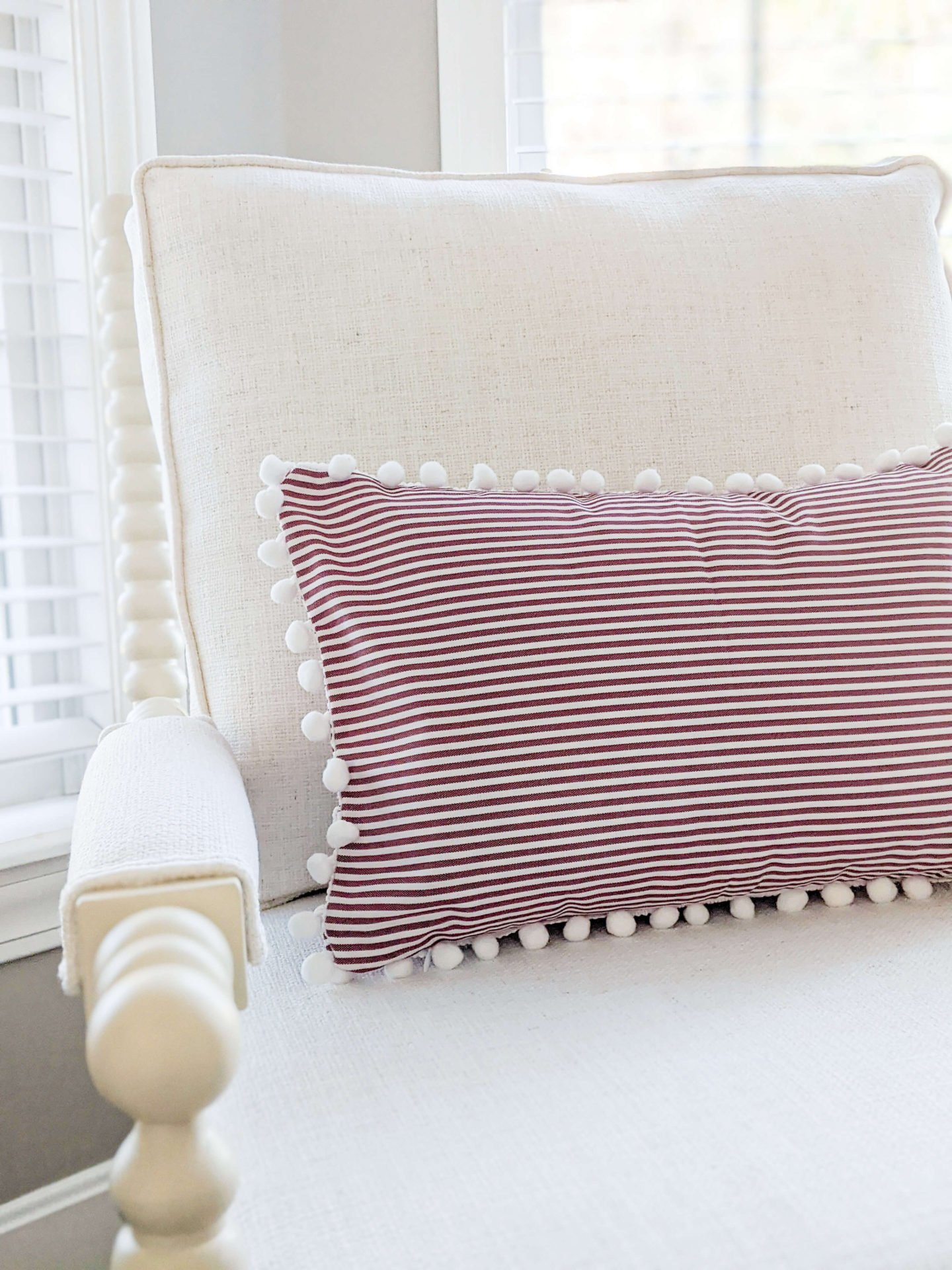Pillows are also on my list of what to buy for Christmas decorations. This red and white striped pillow cover is such a great deal!
