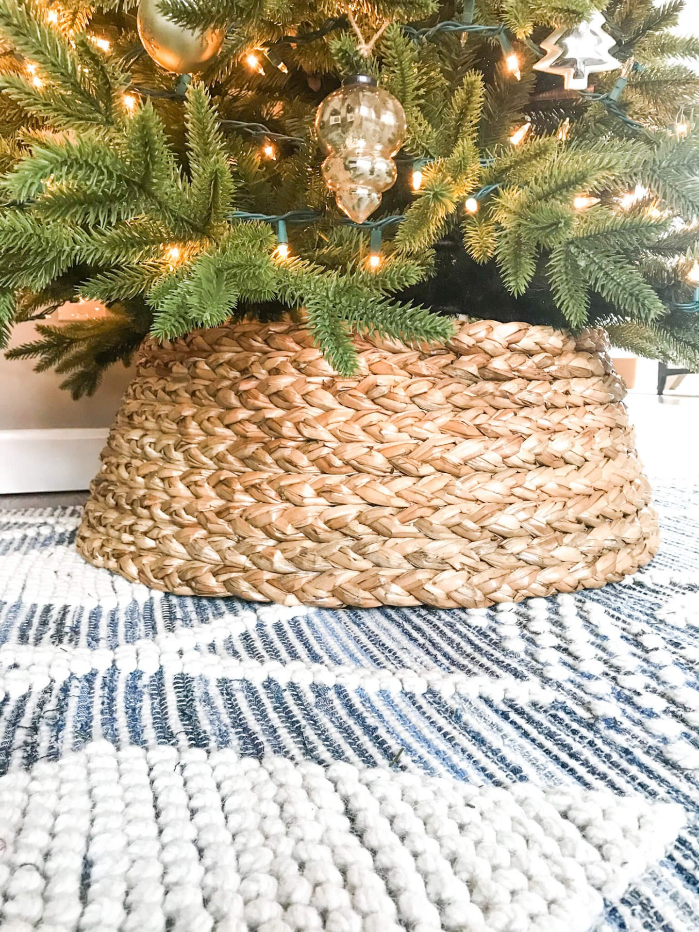 Christmas trees is the number one item on my list of what to buy for Christmas decorations. This basket tree collar makes a great addition to any full-sized tree.