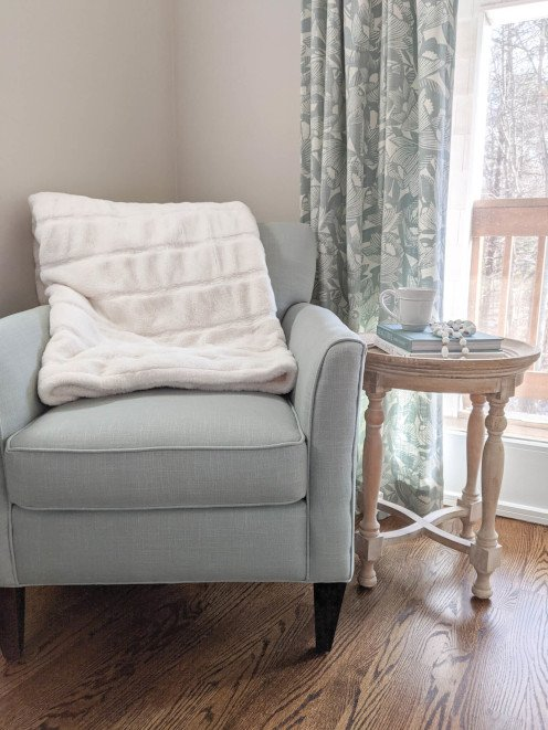 A chunky knit or faux fur throw blanket will add coziness to a room