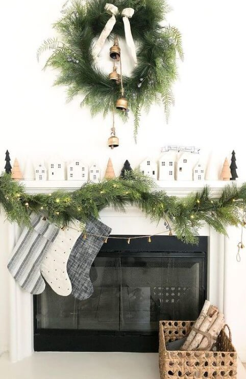 Birch logs in a basket by the fireplace for a cozy living room