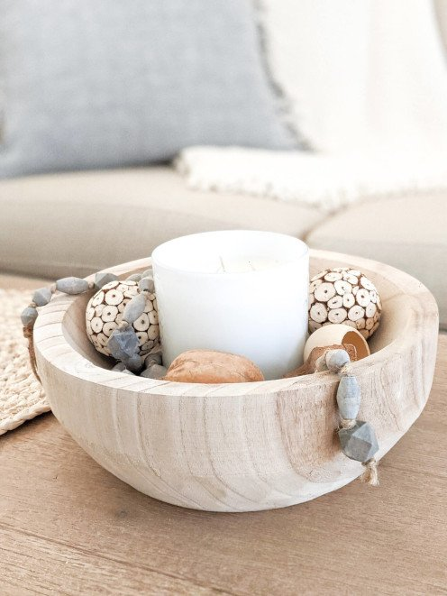 A cozy winter vignette should always include a light source whether it's a candle or twinkle lights.