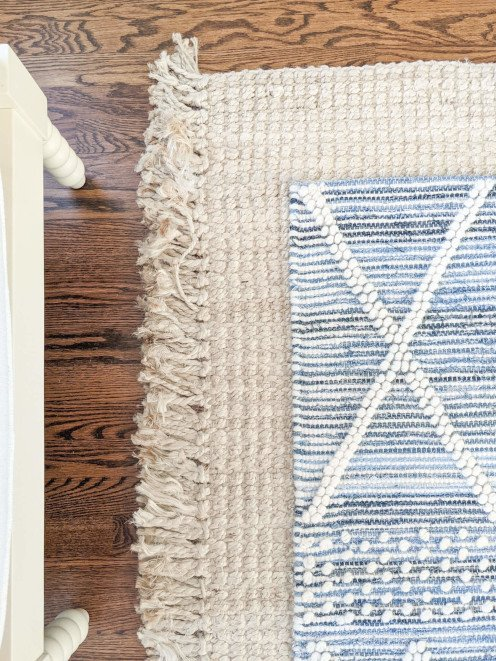 A jute rug layered with another textured rug will add coziness to a room