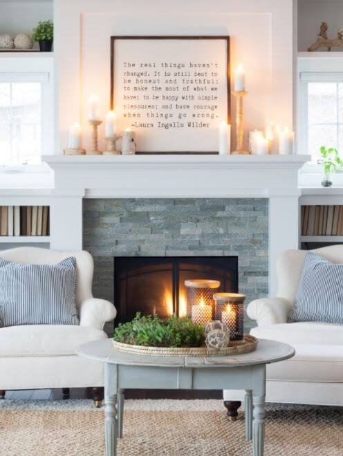 An abundance of candles on the mantel make a living room much cozier in the winter.
